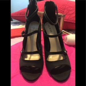 NWOT Guess black Satin gladiators heels.